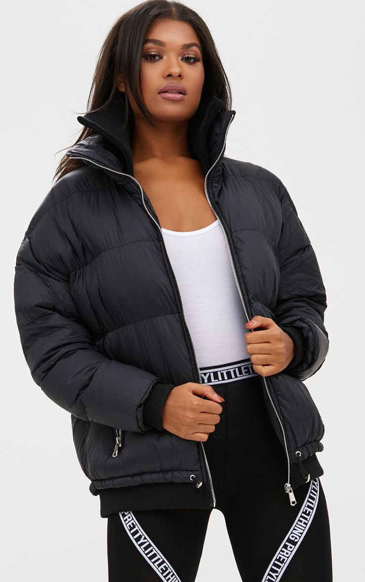Black Oversized Puffer Jacket with Zip Pockets
