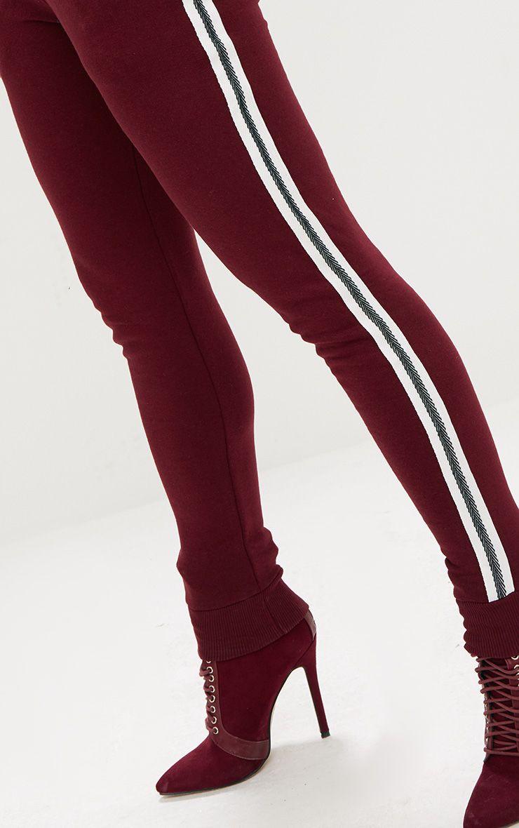 Pantalon de jogging bordeaux bande sur les c t s for T2 sur bordeaux