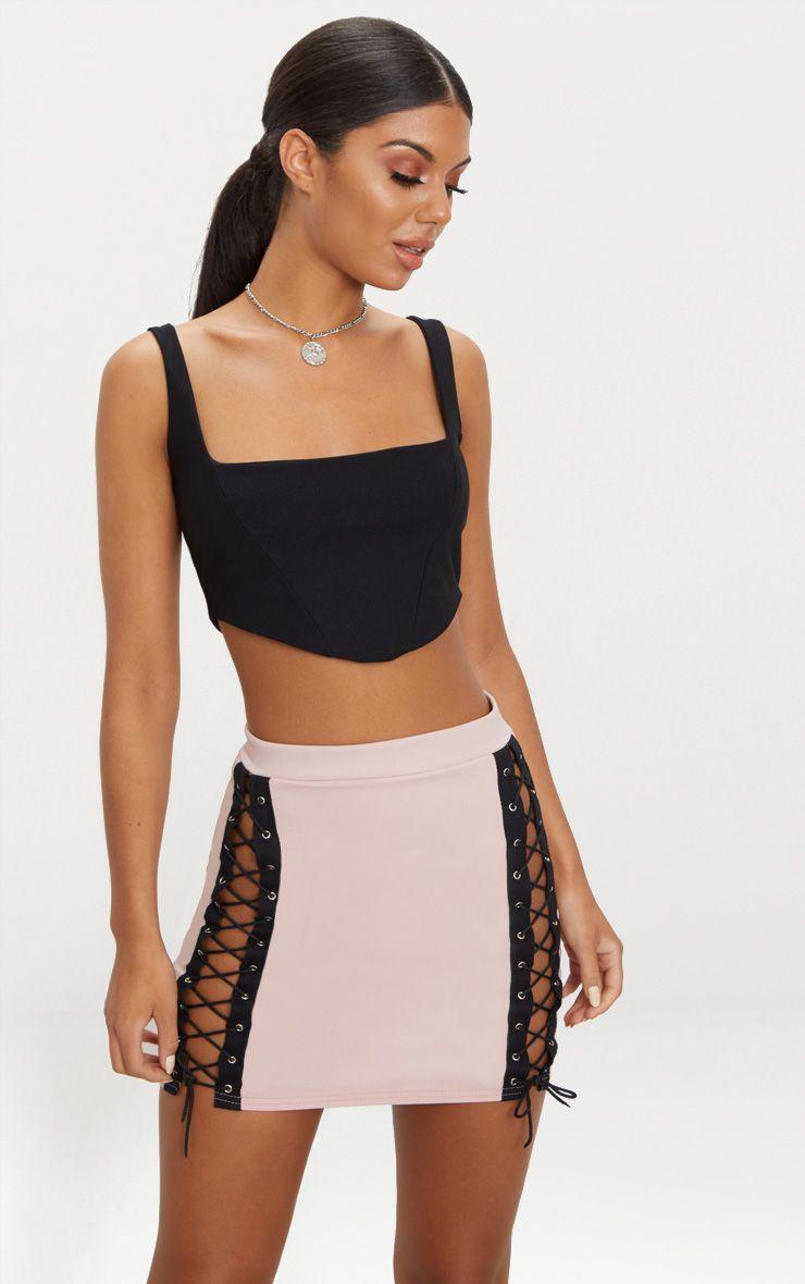 Mini-jupe rose à laçage devant