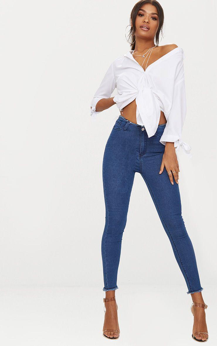 Mid Wash Frayed Edge 5 Pocket Skinny Jean