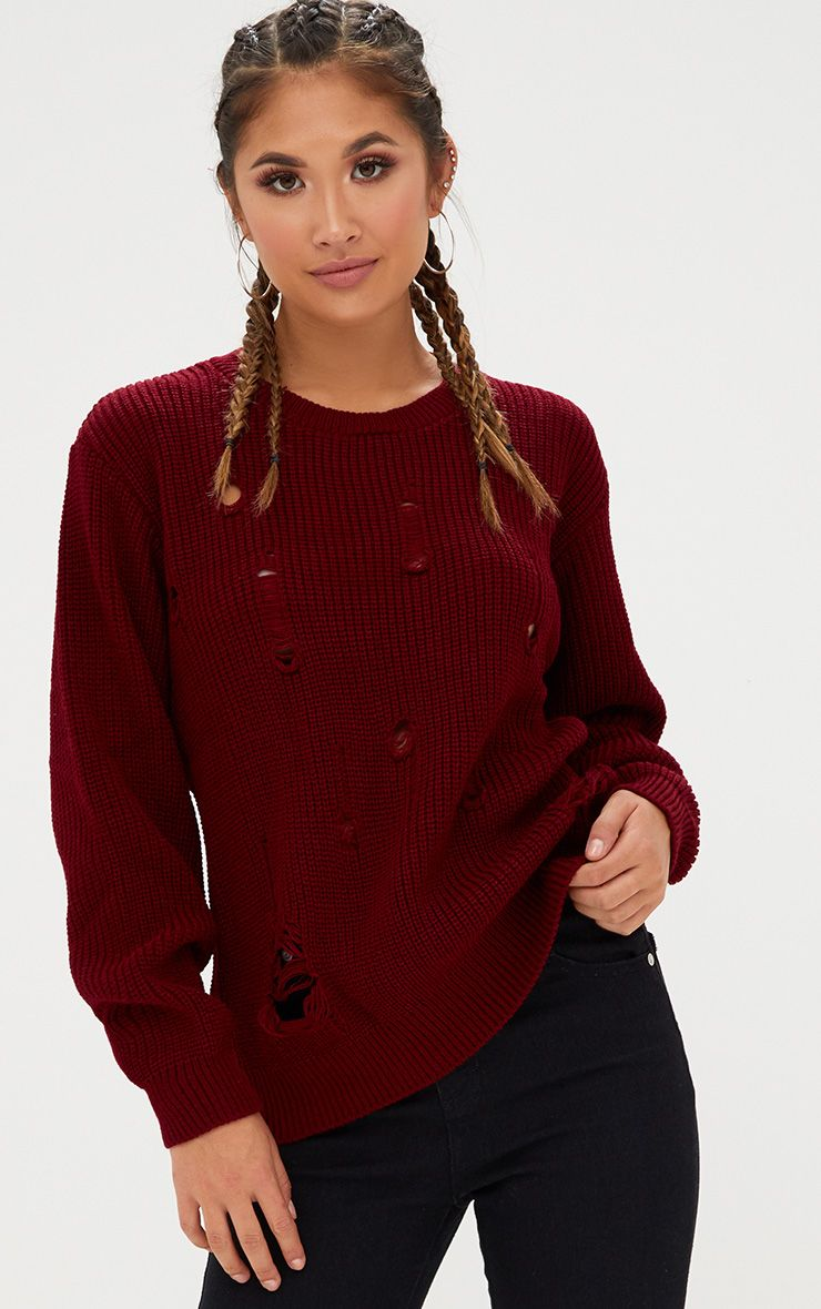 Pull tricoté bordeaux aspect vieilli