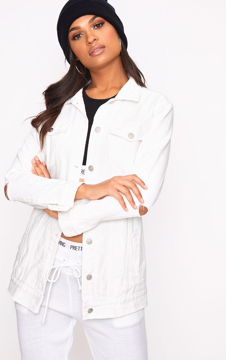 Veste en jean blanche déchirée aux coudes