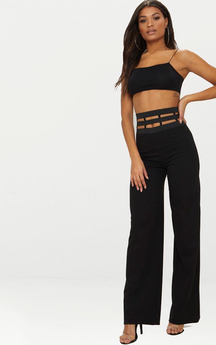 Pantalon noir stretch à coupe évasée et lanières