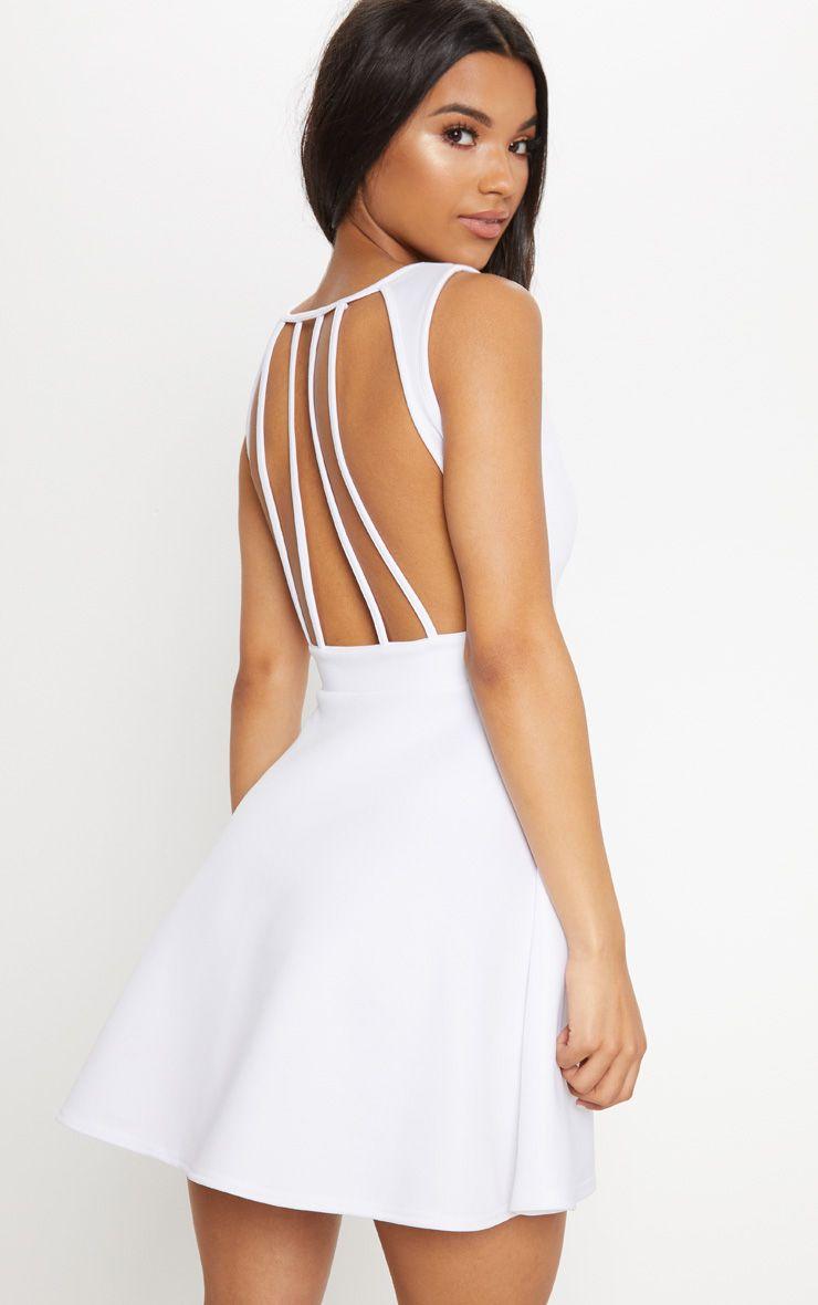 11ed37049 Shoptagr | White Strappy Back Skater Dress by Prettylittlething