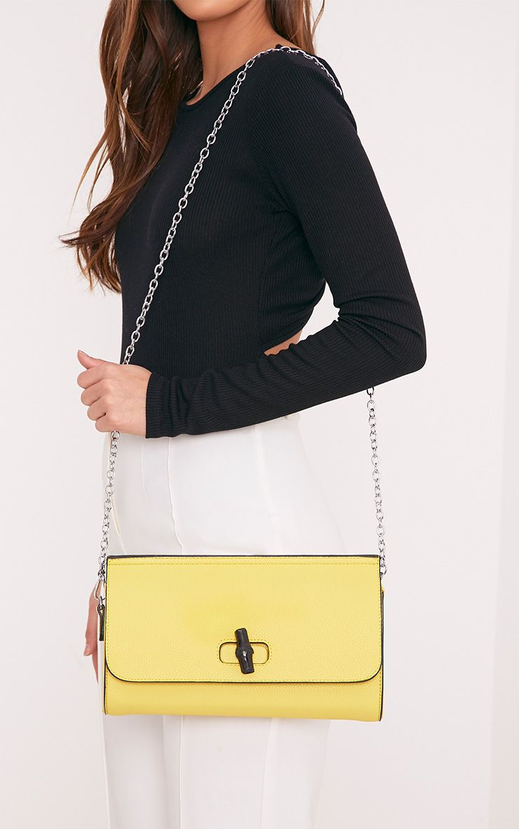 Nennie Yellow Twist Lock Clutch