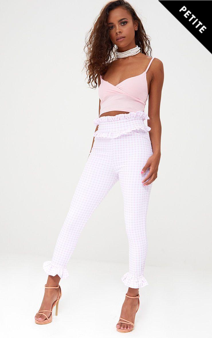 Petite pantalon vichy rose à volants sur l ourlet