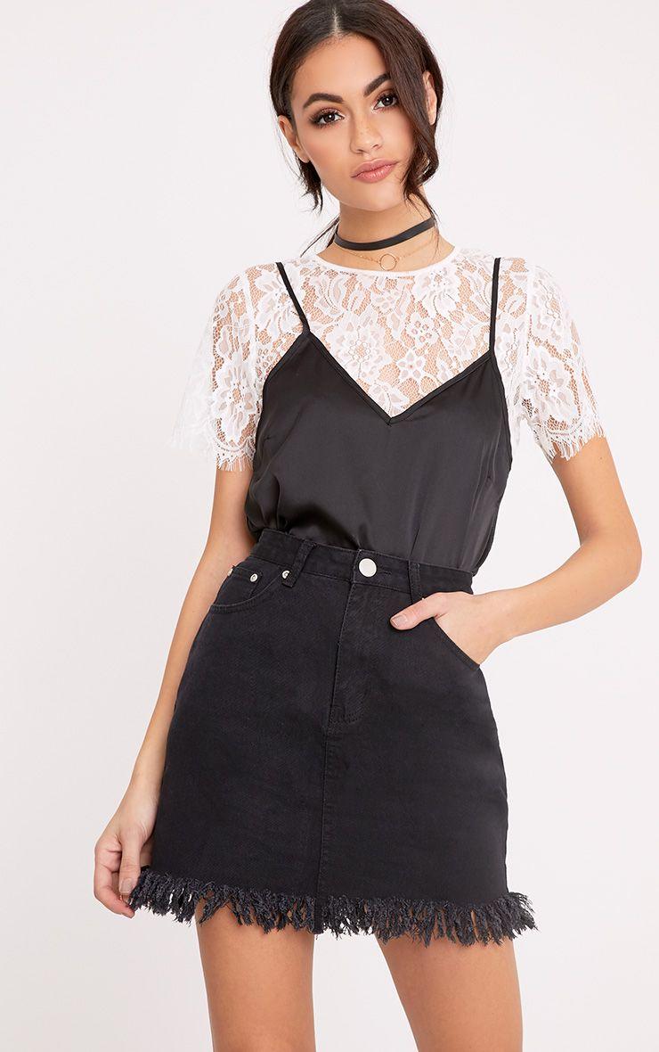 Jasminda minijupe en jean noire à ourlet à franges