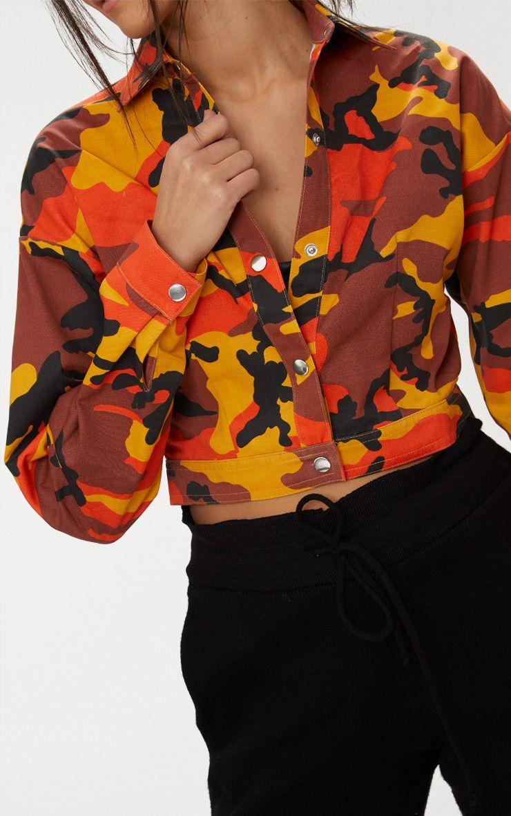 0942b850327bc PrettyLittleThing Orange Cropped Camo Trucker Jacket at £28 | love ...
