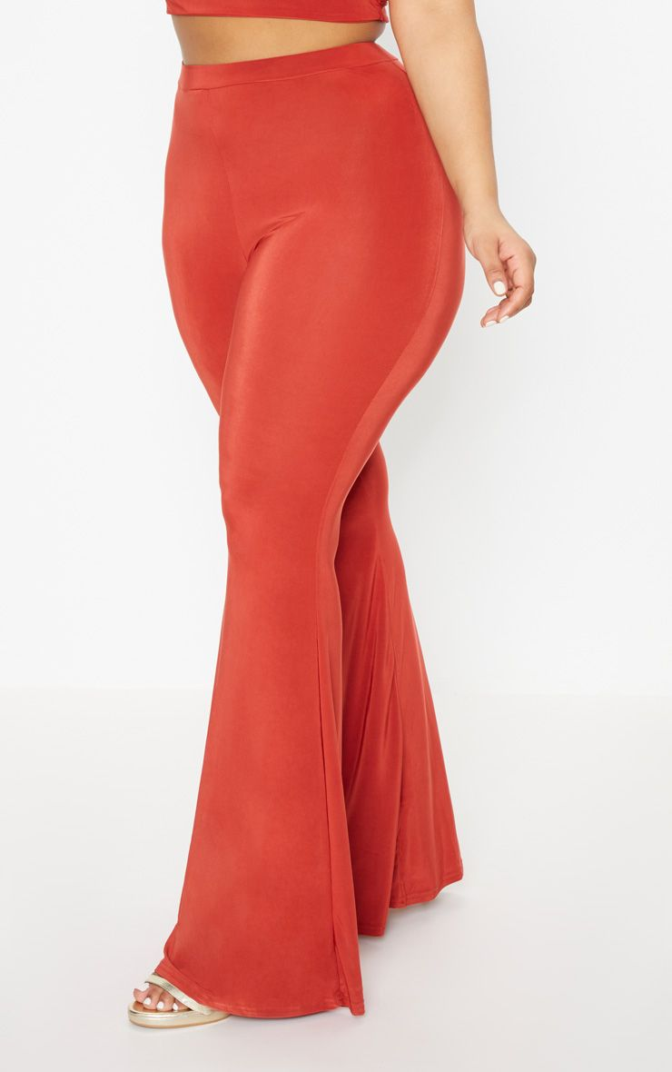 Plus Rust Slinky Flared Leg Trousers
