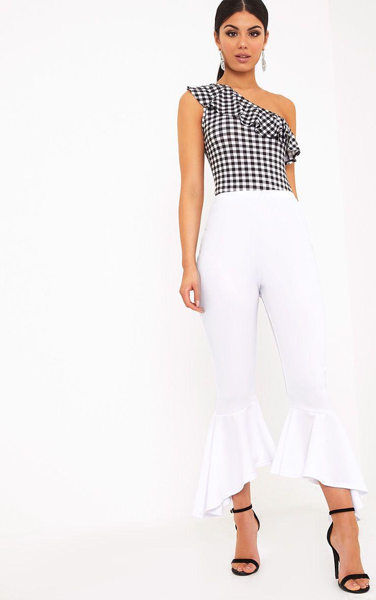 Lourdes pantalon blanc à ourlet évasé asymétrique
