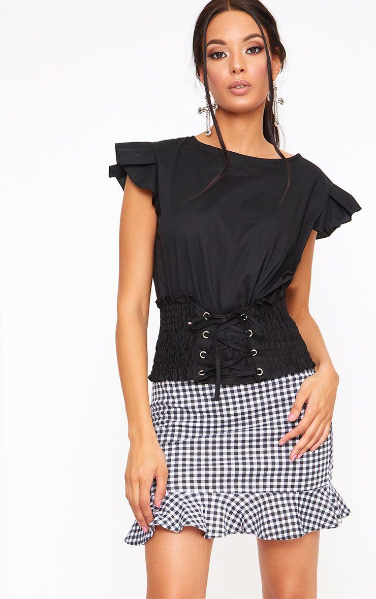 Chemise noire style corset à manches volantées