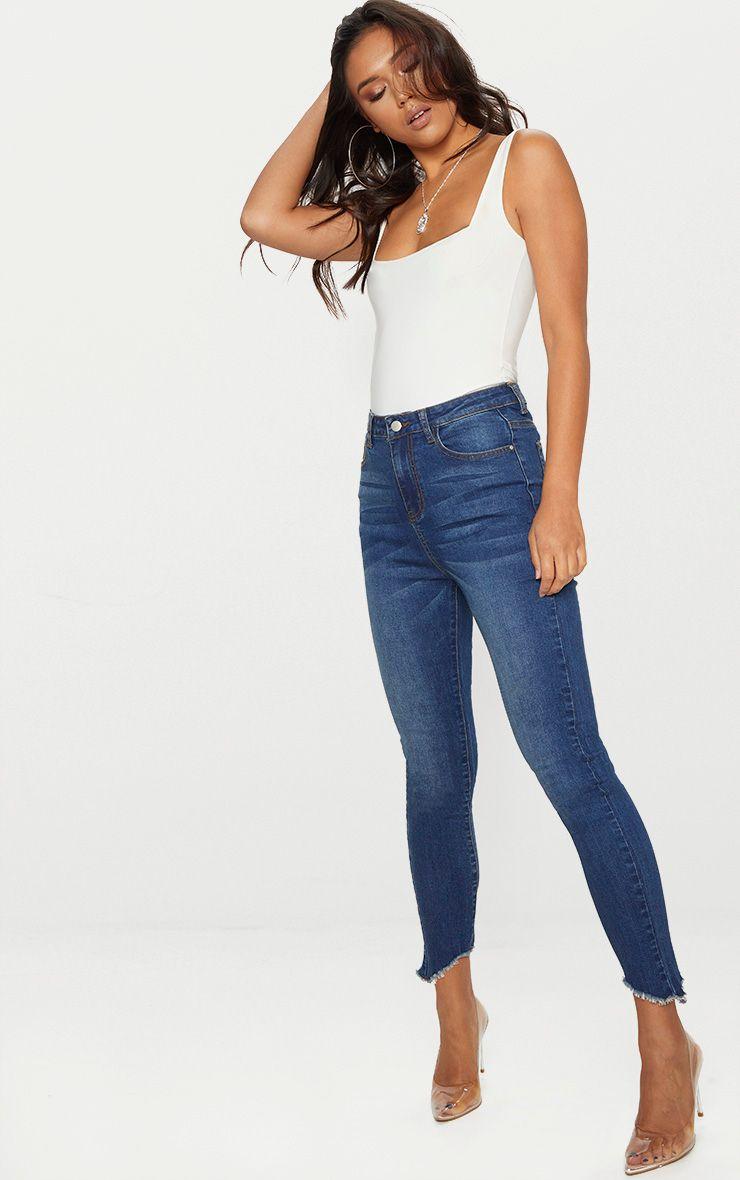 Jean skinny bleu délavage vintage taille haute à ourlets élimés et asymétriques