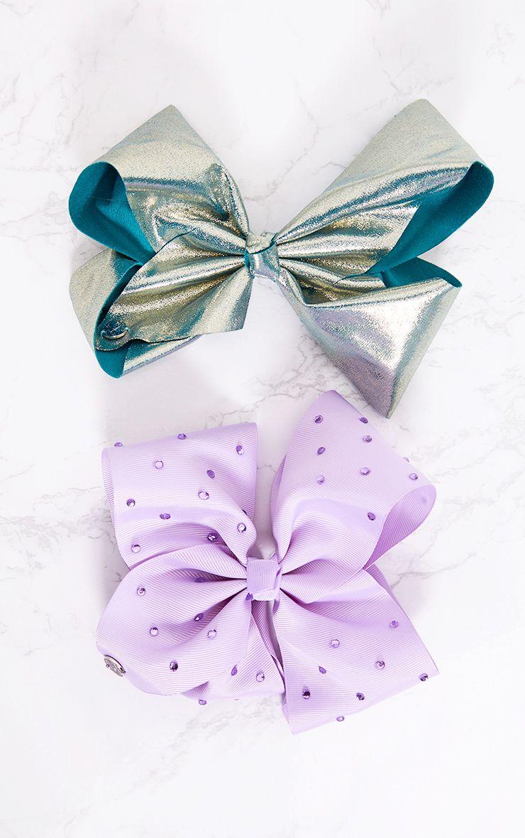 2 nœuds pour cheveux (bleu métallisé et rose)