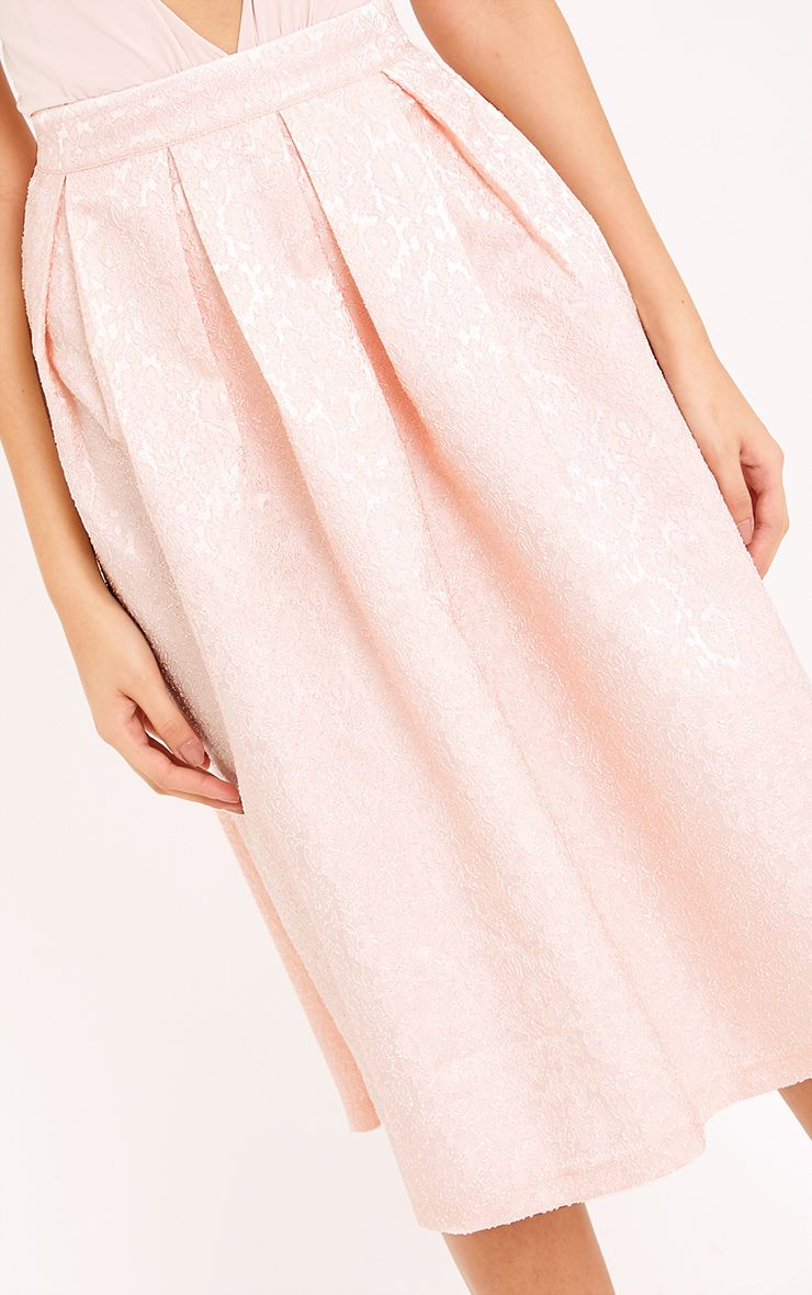 Buy the Jersey Midi Skirt now for $ This drapey midi skirt looks smart and elegant, but is just as chuck-on-able as your favourite T-shirt. Made from our soft and slightly stretchy jersey, it.