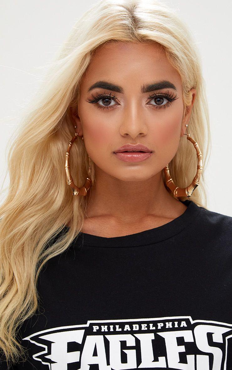 Grandes boucles d oreilles créoles dorées
