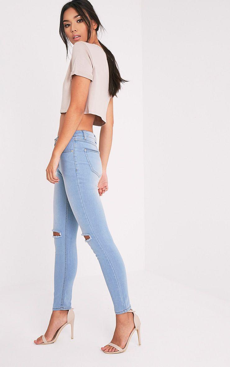 Light Wash Knee Rip Slim Jean 1
