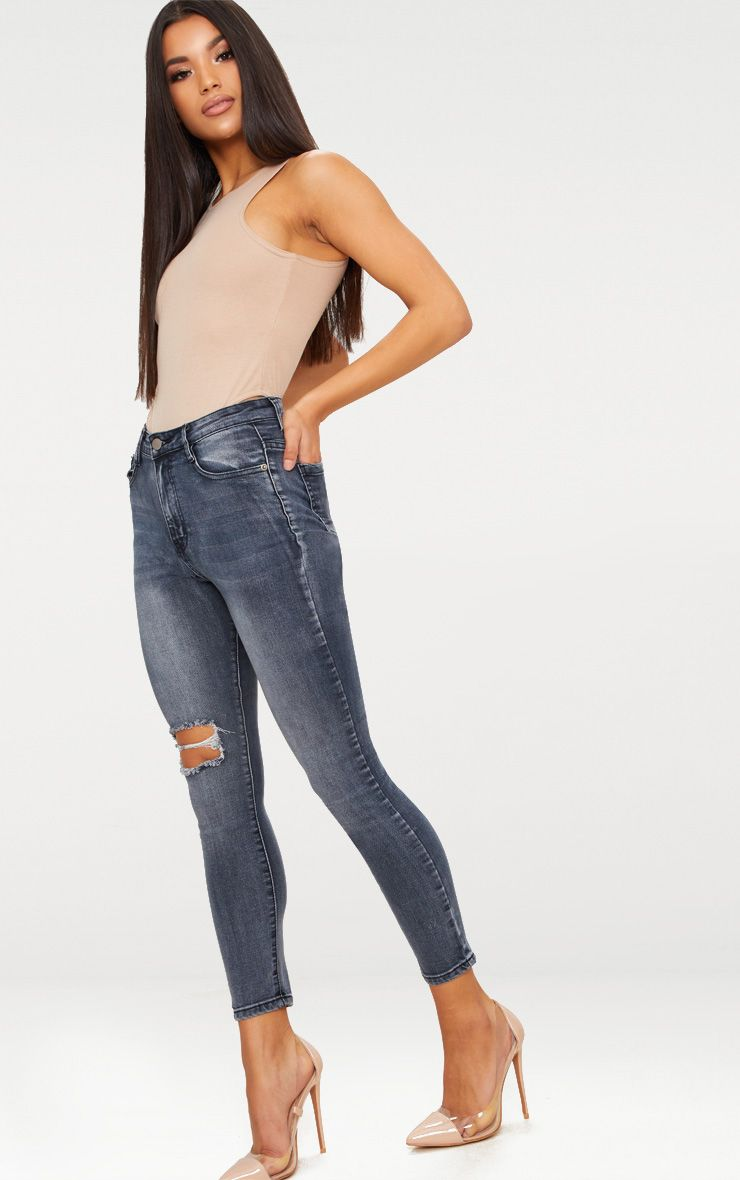Washed Indigo Ripped Knee Skinny Jean