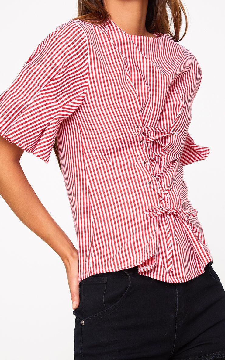 red gingham print corset detail crew neck shirt tops prettylittlething. Black Bedroom Furniture Sets. Home Design Ideas